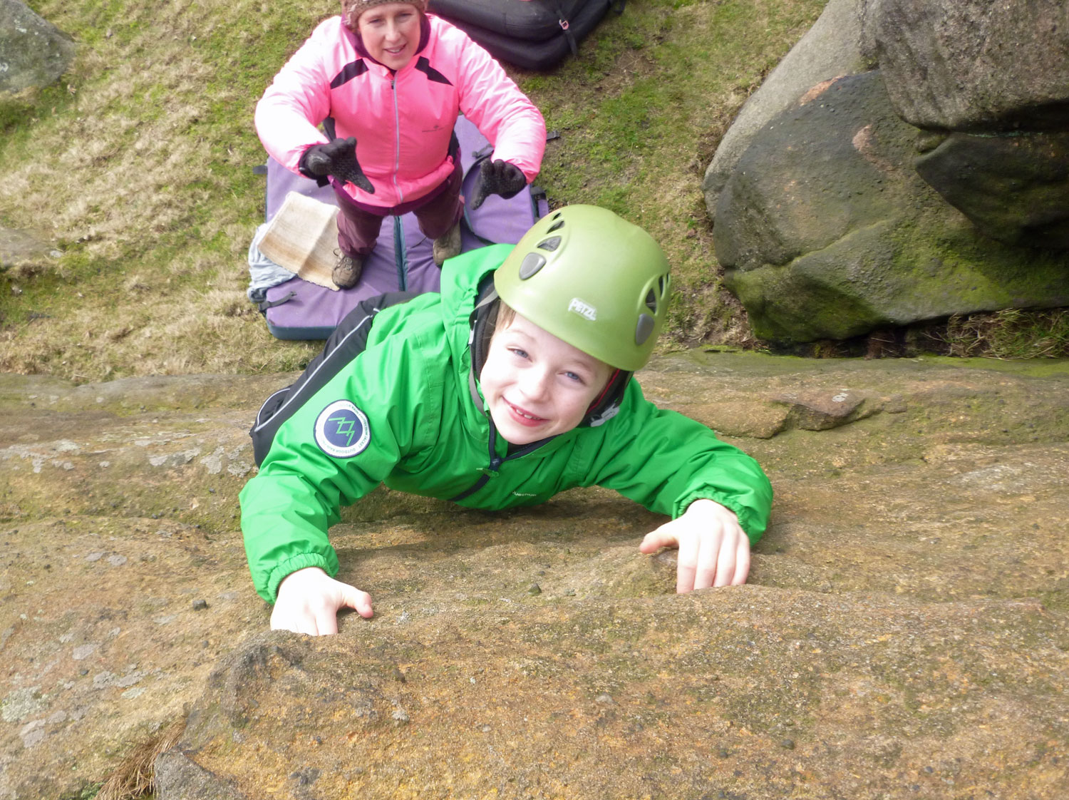 A pupil bouldering in the Peak District