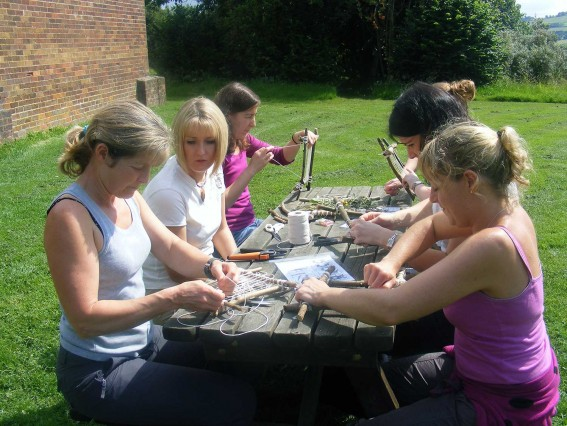 Adults making dream catchers