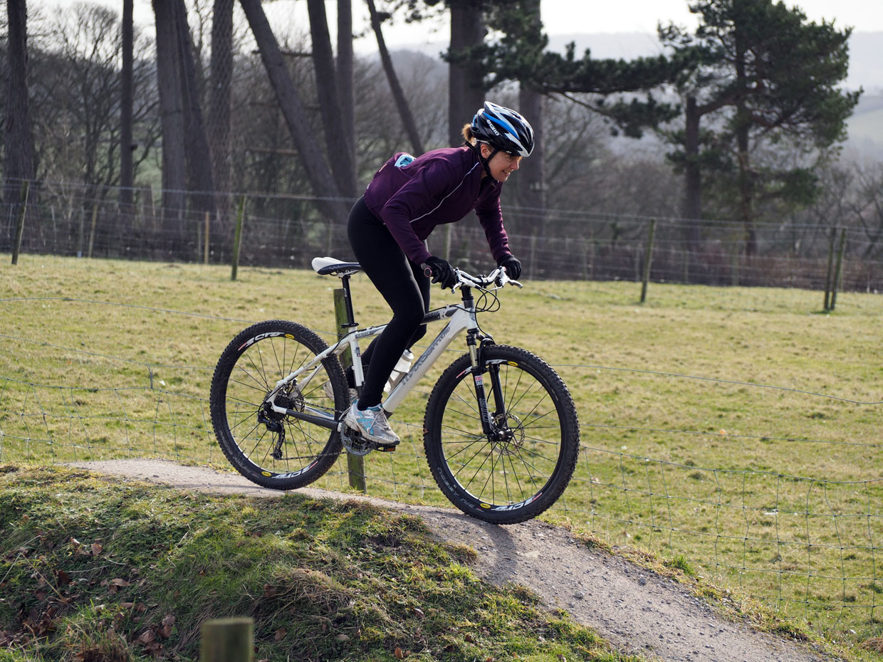 A women mountain biking on the pump track