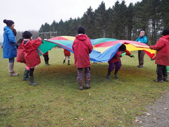 Pupils playing parachute games
