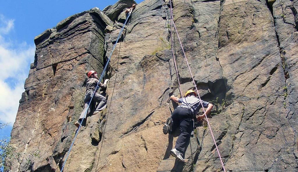 Pupils rock climbing in the Peak District