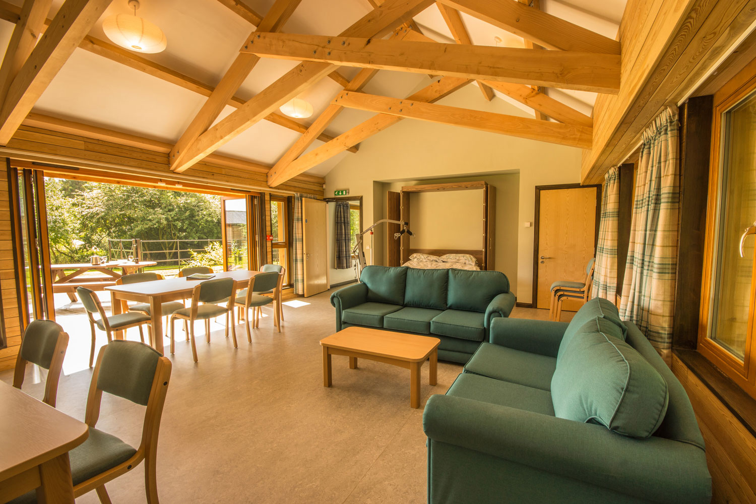 Thornbridge Outdoors, Woodlands, Lounge and Dining Room with Bed