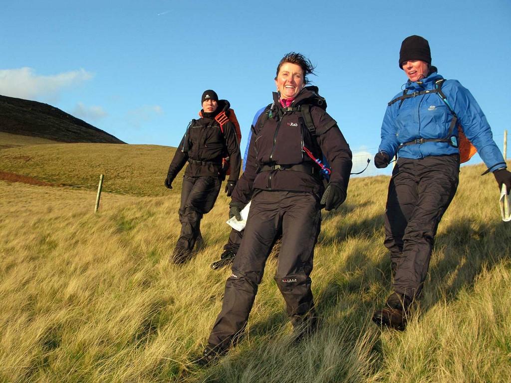 Adults walking in the Peak District