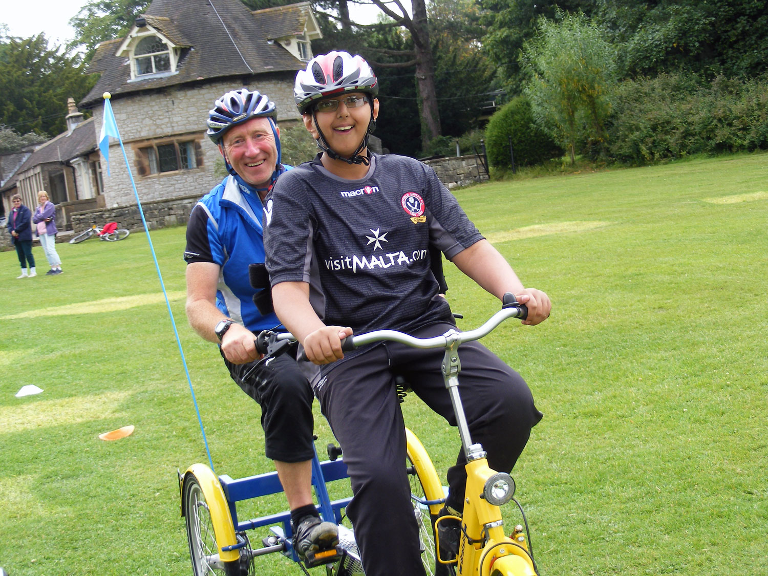 Adult and child on a accessibility trike