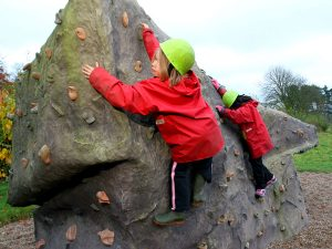 Pupils on the climbing Boulder (rock based activity)