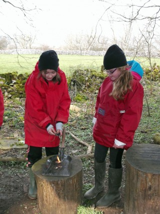 2 children fire lighting (onsite ground-based) at Thornbridge Outdoors