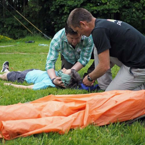 3 people practising first aid on a course