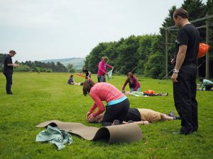 Multiple people practising first aid on a course