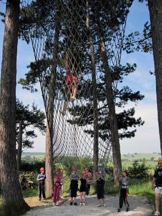 An adult and pupils on the cargo net