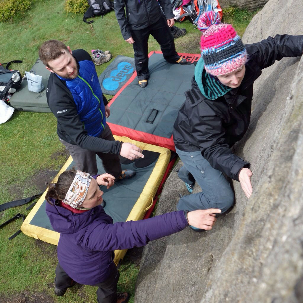 Adults learning to boulder