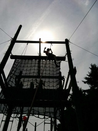 Pupils on the ladder and net climb (high ropes) at Thornbridge Outdoors