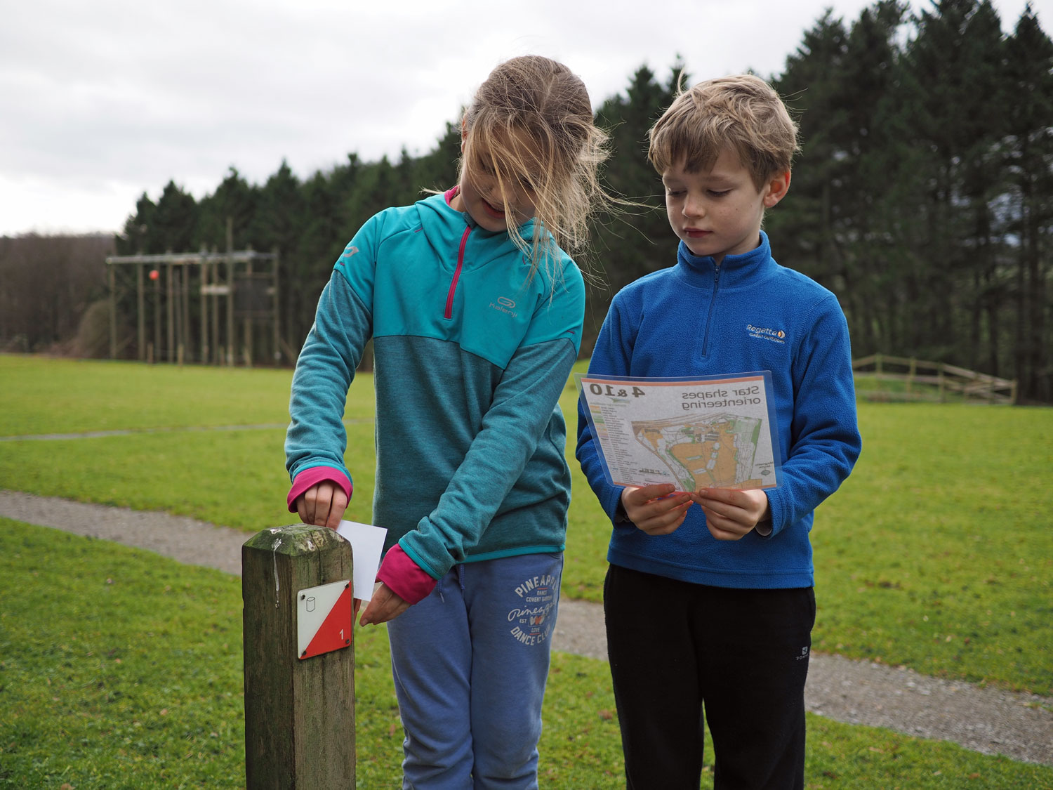 2 children orienteering (onsite ground-based) at Thornbridge Outdoors