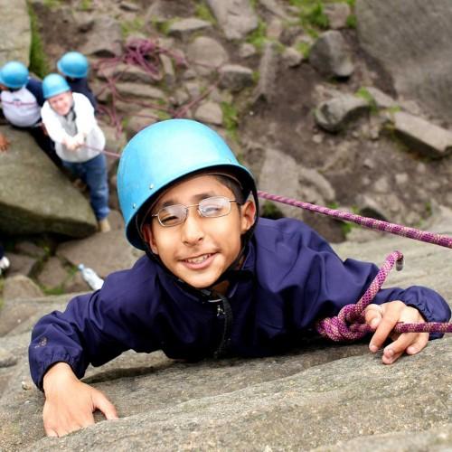 Pupil rock climbing