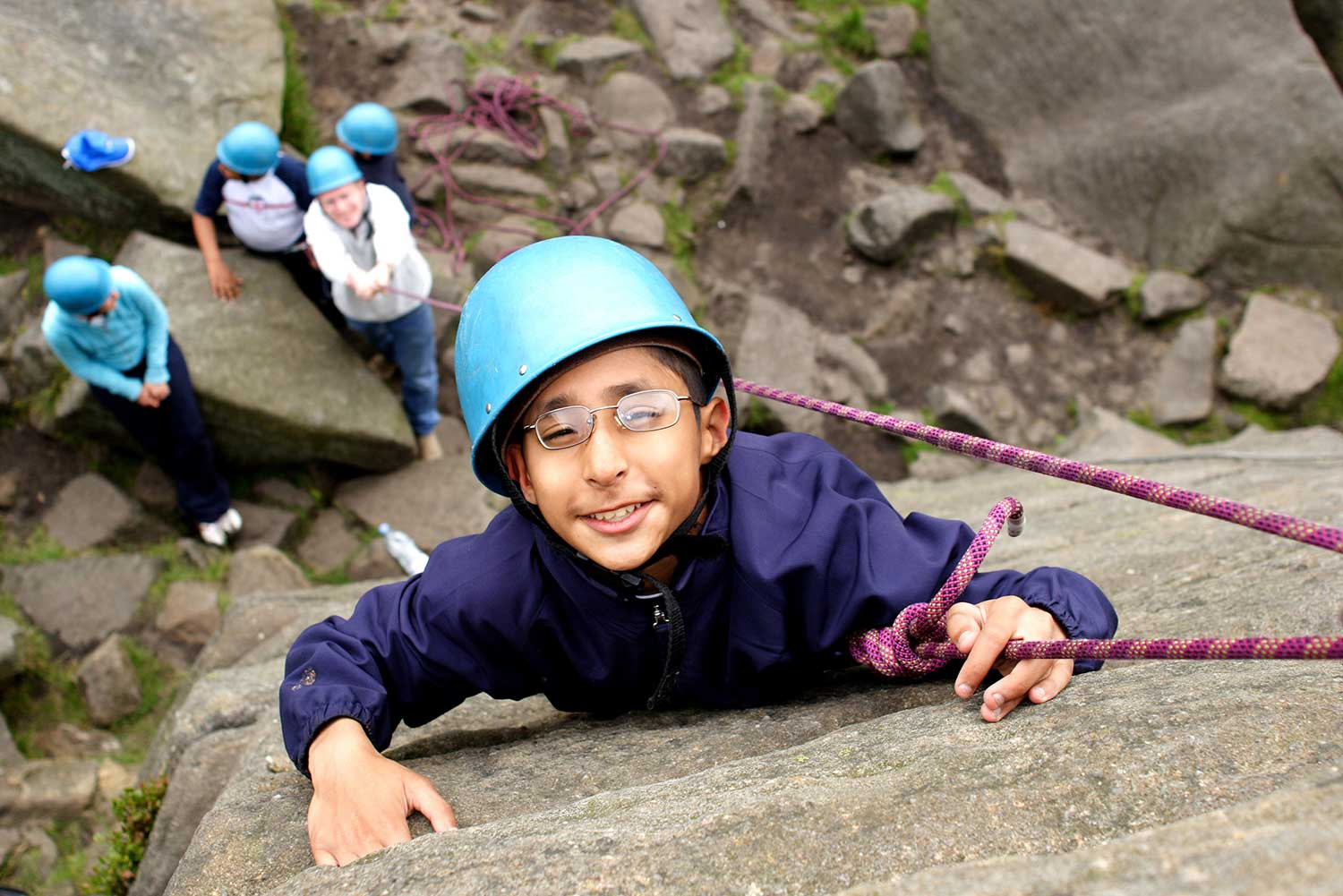Pupil rock climbing in the Peak District