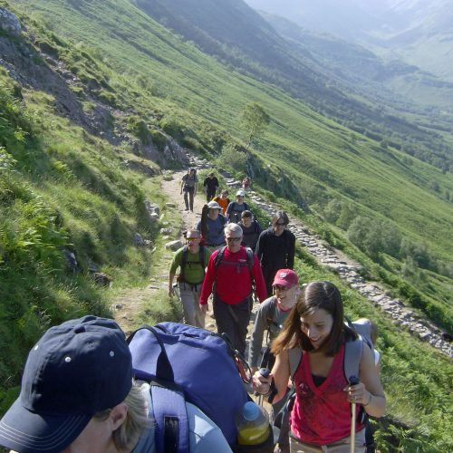 Adults walking up a mountain