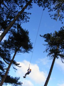School pupil on the zip wire (high ropes) at Thornbridge Outdoors