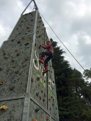 A pupil on the climbing tower at Thornbridge Outdoors
