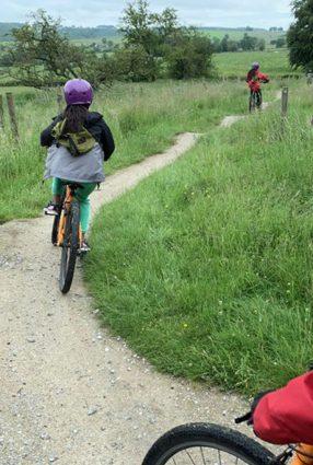 Children ride bikes in the grounds of Thornbridge Outdoors