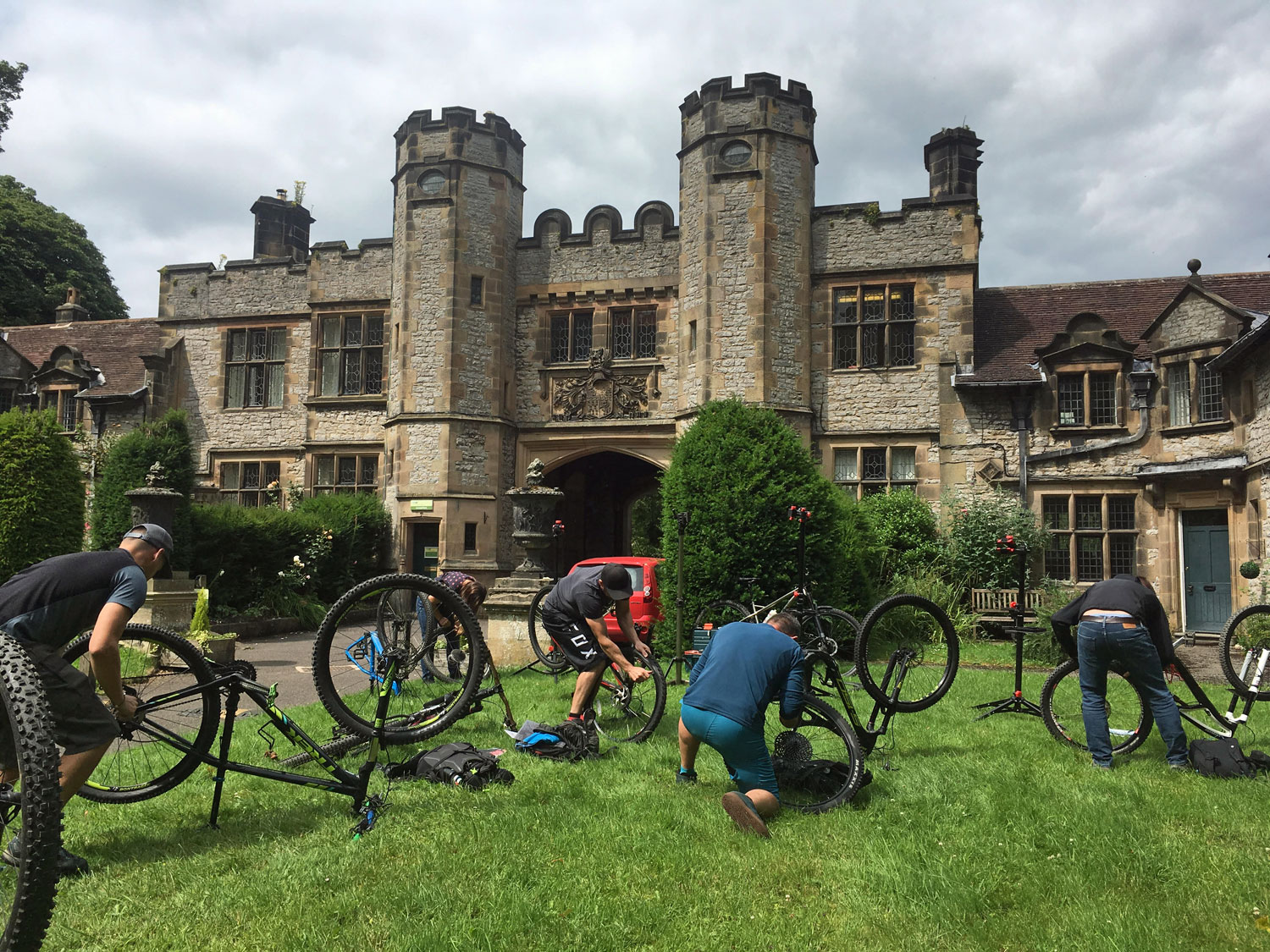 Course participants fixing their bikes on a British Cycling Level 2 MTB Course